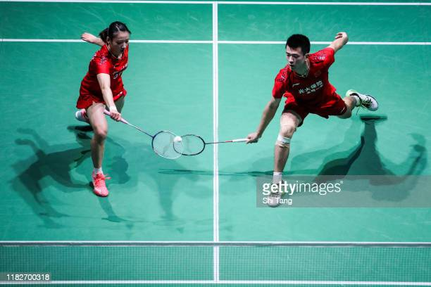 Zheng Siwei and Huang Yaqiong of China compete in the Mixed Doubles first round match against Goh Soon Huat and Lai Shevon Jemie of Malaysia on day...