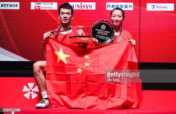 Zheng Siwei and Huang Yaqiong of China pose with the trophy after their Mixed Double final match against Wang Yilyu and Huang Dongping of China on...
