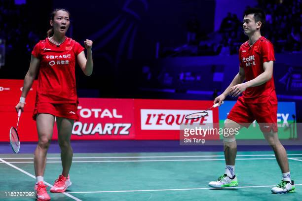 Zheng Siwei and Huang Yaqiong of China react in the Mixed Double final match against Praveen Jordan and Melati Daeva Oktavianti of Indonesia on day...