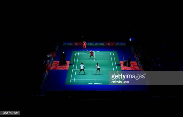 Zheng Siwei and Hunag Yaqiong of China of compete against Yuta Watanabe and Arisa Higashino of Japan on day five of the Yonex All England Open...