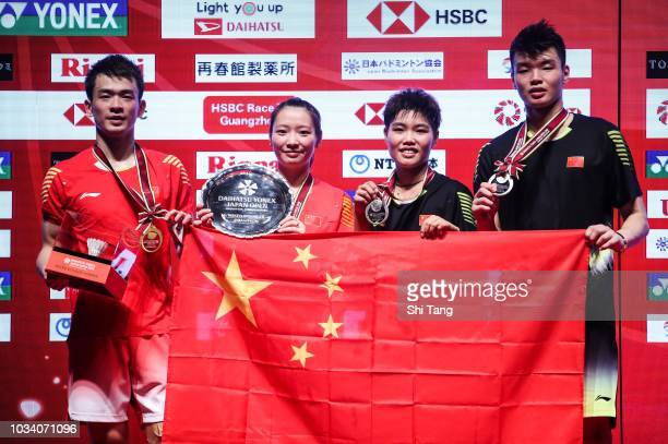 Zheng Siwei Huang Yaqiong Huang Dongping and Wang Yilyu pose with their medals after the Mixed Double final match on day six of the Yonex Japan Open...