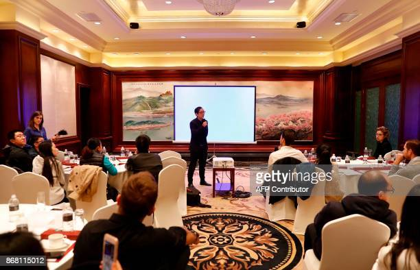 Zheng Yi CEO of ESEE Model Management speaks to the media during a press briefing in Shanghai on October 30 2017 The Chinese agency representing a...