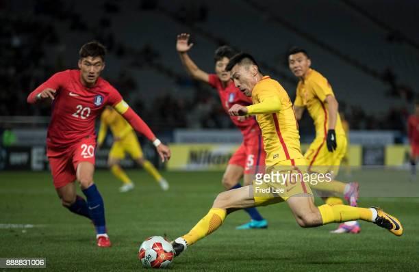 Zheng zheng of china and Jang Hyunsoo of South Korea in action during the EAFF E1 Men's Football Championship between South Korea and China at...