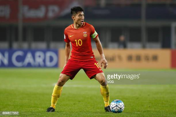 Zheng Zhi of China and controls the ball during the 2018 FIFA World Cup Qualifying group match between China and South Korea at Helong Stadium on...