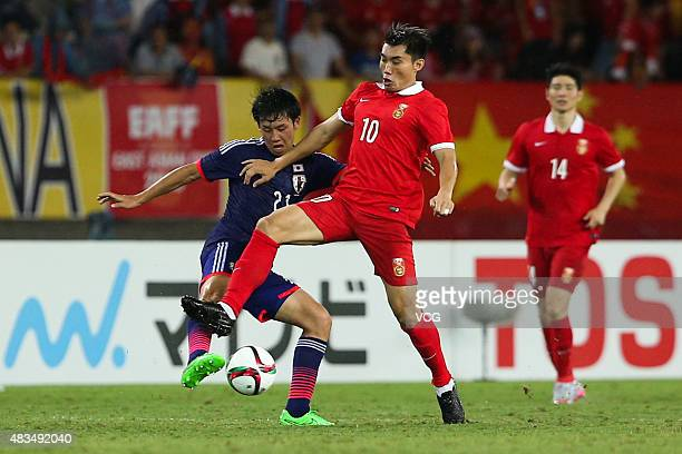 Zheng Zhi of China competes for the ball against Wataru Endo of Japan during men's EAFF East Asian Cup 2015 match between China and Japan at the...