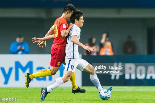 Zheng Zhi of China PR competes for the ball with Koo Jacheol of Korea Republic during their 2018 FIFA World Cup Russia Final Qualification Round...