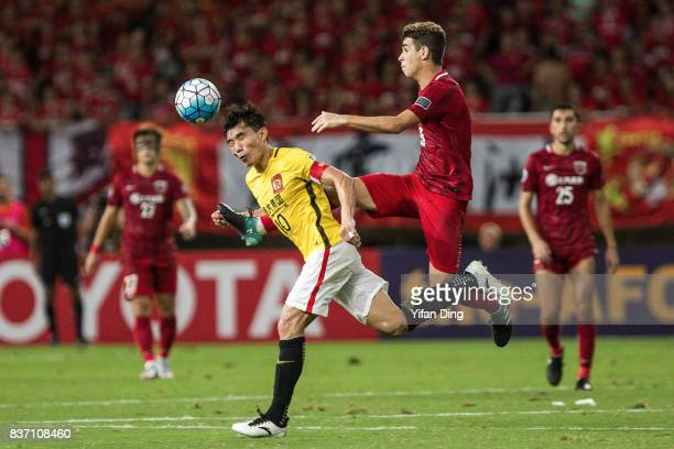 Zheng Zhi of Guangzhou Evergrande and Oscar of Shanghai SIPG fight for the ball during the AFC Champions League 2017 Quarterfinals 1st leg between...