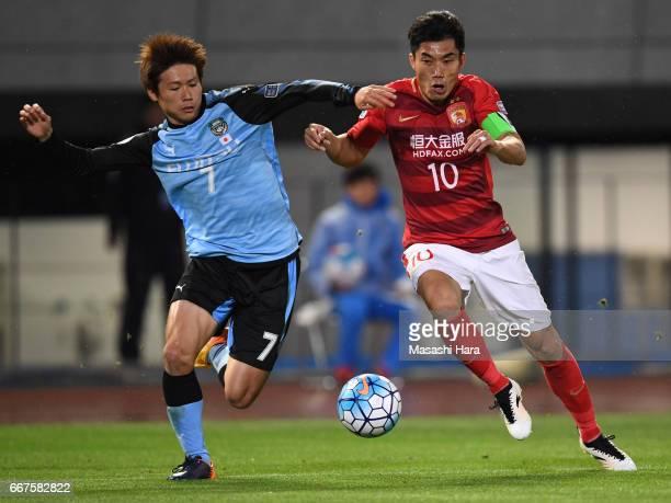 Zheng Zhi of Guangzhou Evergrande and Shintaro Kurumaya of Kawasaki Frontale compete for the ball during the AFC Champions League Group G match...