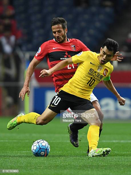 Zheng Zhi of Guangzhou Evergrande and Zlatan Ljubijankic of Urawa Red Diamonds compete for the ball during the AFC Champions League Group H match...