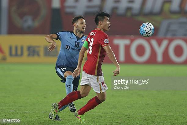 Zheng Zhi of Guangzhou Evergrande compete the ball against Milos Ninkovic of Sydney FC during the AFC Asian Champions League match between Guangzhou...