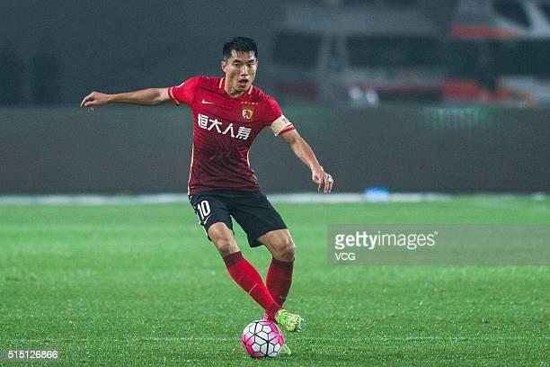 Zheng Zhi of Guangzhou Evergrande drives the ball during the Chinese Football Association Super League match between Guangzhou Evergrande and...