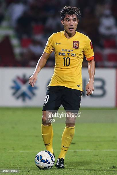 Zheng Zhi of Guangzhou Evergrande drives the ball during the first leg of the AFC Champions League final match between Al Ahli and Guangzhou...