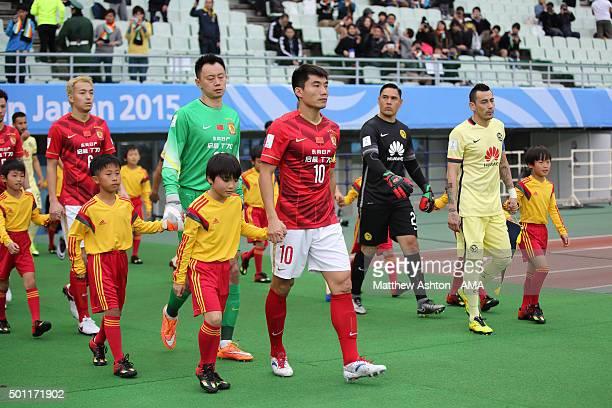 Zheng Zhi of Guangzhou Evergrande FC leads out the teams during the FIFA Club World Cup quarter final between the Club America and Guangzhou...