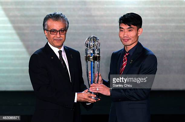 Zheng Zhi of Guangzhou Evergrande FC of China receives the AFC Player of the Year 2013 Award from the AFC President Sheikh Salman bin Ibrahim Al...