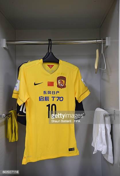 Zheng Zhi of Guangzhou Evergrande FC shirt hangs in the dressing room before the FIFA Club World Cup 3rd Place Match between Sanfrecce Hiroshima and...