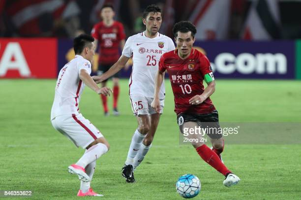 Zheng Zhi of Guangzhou Evergrande in action against Wu Lei and Akhmedov Odil of Shanghai SIPG during the AFC Champions League 2017 Quarterfinals 2nd...