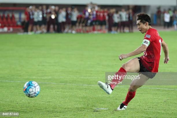 Zheng Zhi of Guangzhou Evergrande scores a penalty during the AFC Champions League 2017 Quarterfinals 2nd leg between Shanghai SIPG and Guangzhou...