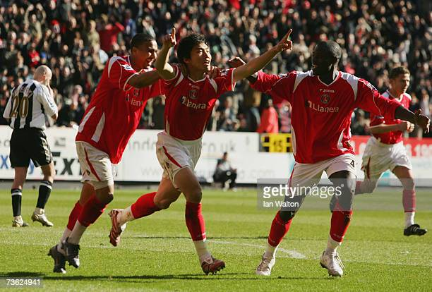 ZhengZhi of Charlton Athletic celebrates as he scores their first goal with team mates Jerome Thomas and Mady fayeduring the Barclays Premiership...