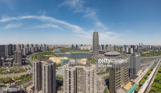 zhengzhou cityscape with international convention and exhibition center, zhengzhou, henan, china - zhengzhou stock pictures, royalty-free photos & images