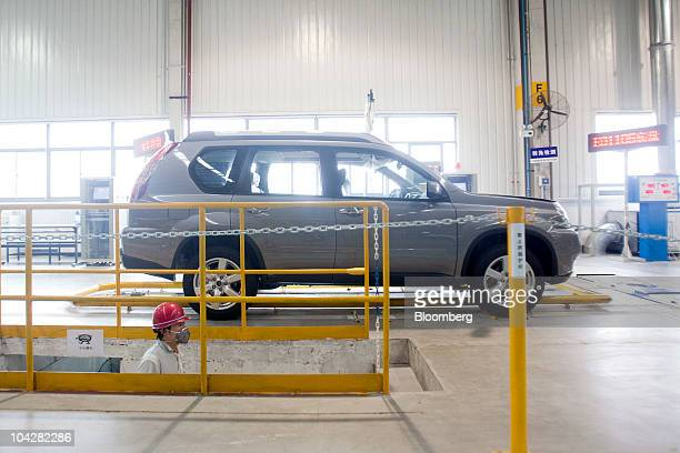 A Zhengzhou Nissan Automobile Co Ltd XTrail sport utility vehicle is tested at the factory in Zhengzhou Henan province China on Monday Sept 20 2010...