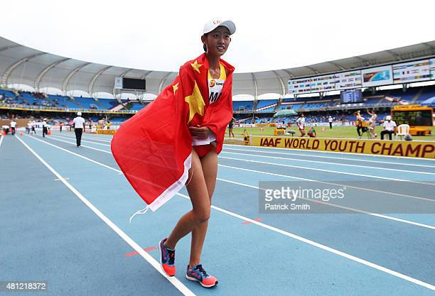 Zhenxia Ma of China celebrates after winning the Girls 5000 Meters Race Walk Final on day four of the IAAF World Youth Championships Cali 2015 on...