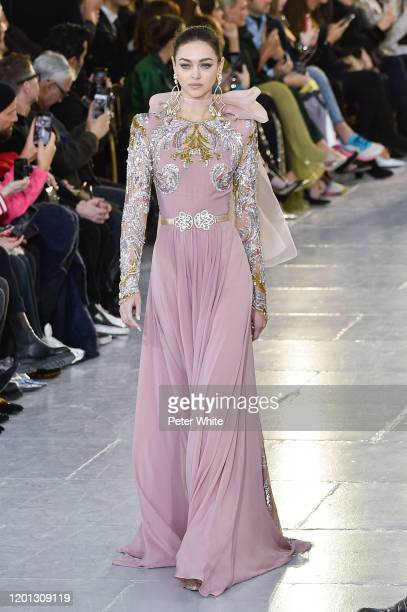 Zhenya Katava walks the runway during the Elie Saab Haute Couture Spring/Summer 2020 show as part of Paris Fashion Week on January 22, 2020 in Paris,...