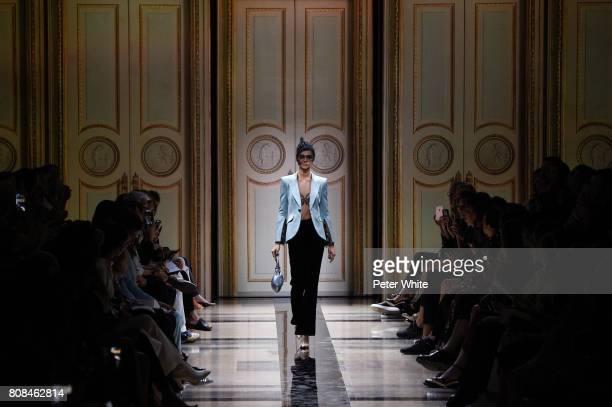 Zhenya Katava walks the runway during the Giorgio Armani Prive Haute Couture Fall/Winter 20172018 show as part of Haute Couture Paris Fashion Week on...