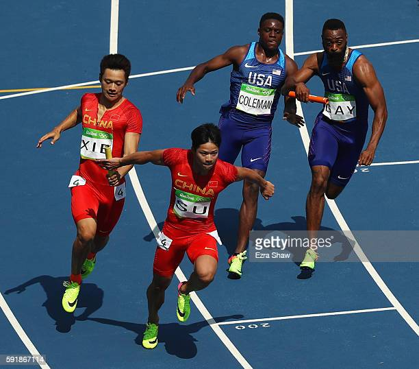 Zhenye Xie hands off to Bingtian Su of China as Christian Coleman hands off to Tyson Gay of the United States in round one of the Men's 4 x 100m...