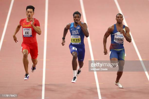 Zhenye Xie of China Noah Lyles of the United States and Alex Quiñónez of Ecuador compete in the Men's 200 metres semi finals during day four of 17th...