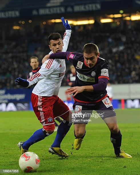 Zhi Gin Lam of Hamburg challenges for the ball with Remo Mally of Vienna during the international friendly match between Hamburger SV and Austria...