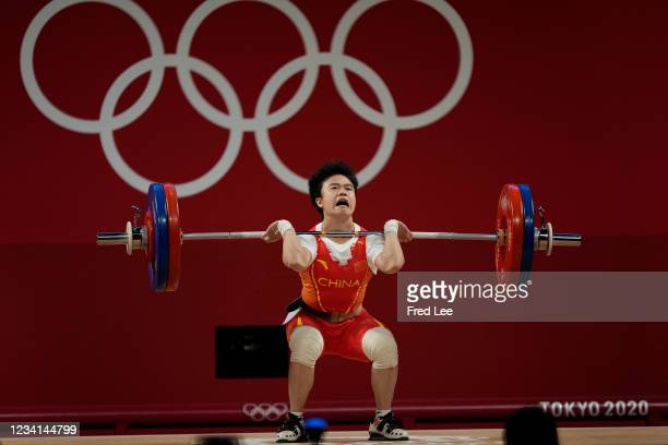 Zhihui Hou of Team China competes during the Weightlifting - Women's 49kg Group A on day one of the Tokyo 2020 Olympic Games at Tokyo International...