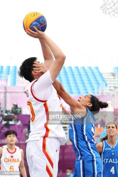 Zhiting Zhang of Team China drives to the basket under pressure from Raelin D Alie of Team Italy during the Women's Pool Round match between China...