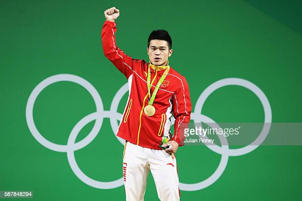 Zhiyong Shi of China celebrates winning the gold medal during the Men's 69kg Group A Weightlifting contest on Day 4 of the Rio 2016 Olympic Games at...