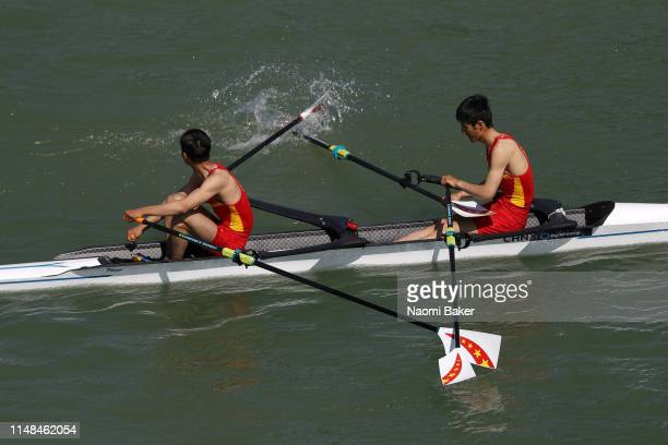 Zhiyuan Zhang and Fanpu Lyu of China react at after they cross the line with one blade back to front after catching a crab and losing the Lightweight...