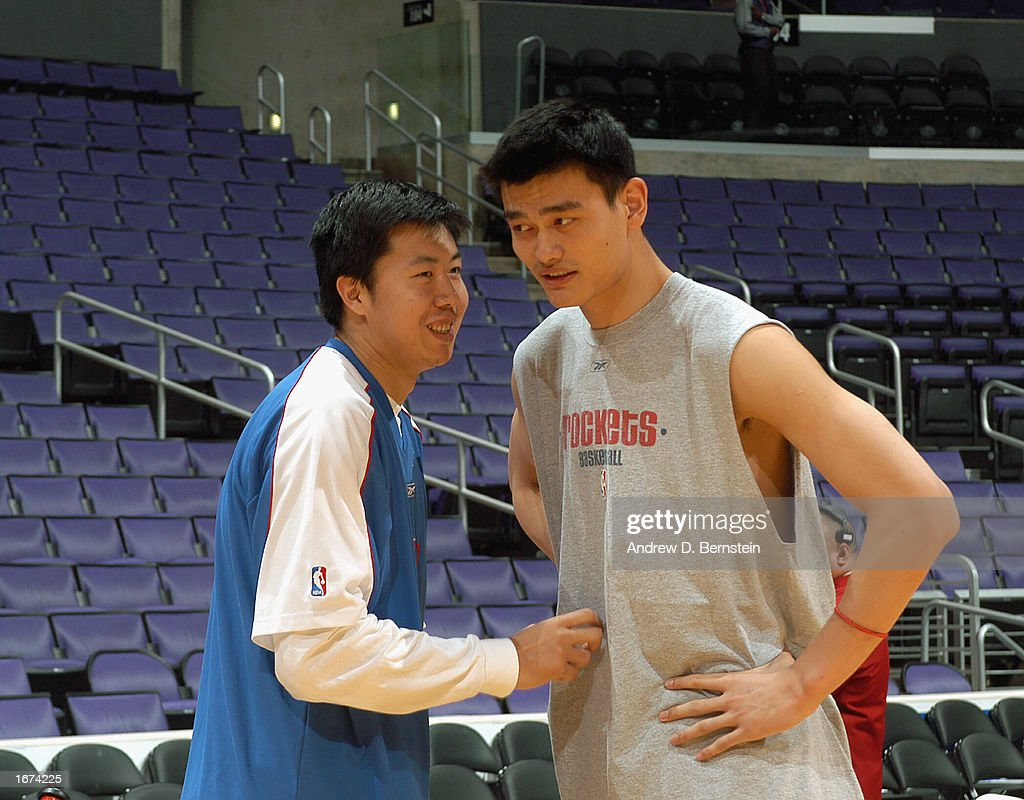 Zhizhi Wang #16 of the Los Angeles Clippers talks to Yao Ming #11 of the the Houston Rockets before the game at Staples Center on November 24, 2002 in Los Angeles, California. The Clippers won 90-89.