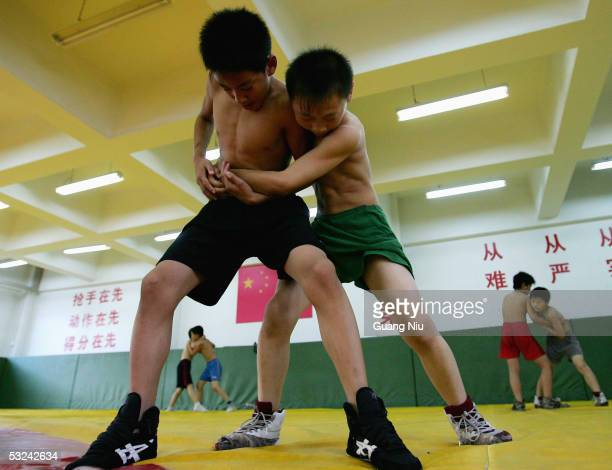 Zhong Ximing and Wang Xuelong both 13 yearold train during a wrestling course of Sports School of Dongcheng District on July 14 2005 in Beijing China...