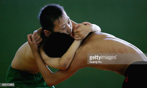 Zhong Ximing and Wang Xuelong both 13 yearold train during a wrestling course of Sports School of Dongcheng District on July 14 2005 in Beijing China...