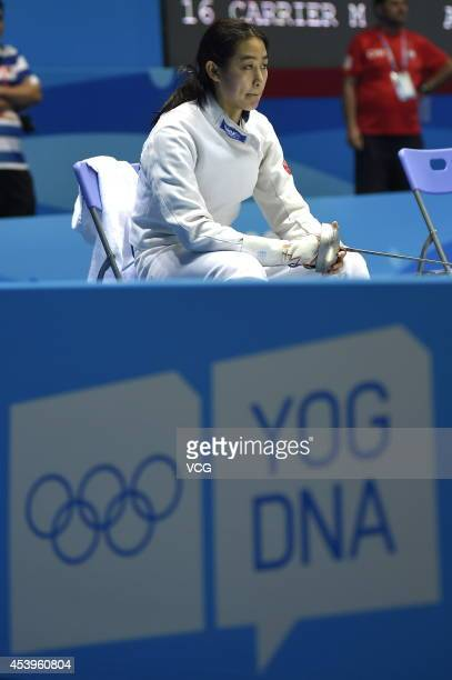 Zhong Xiuting of China reacts in the Women's Fencing Ranking Round at International Expo Centre Hall E during day six of the Nanjing 2014 Summer...