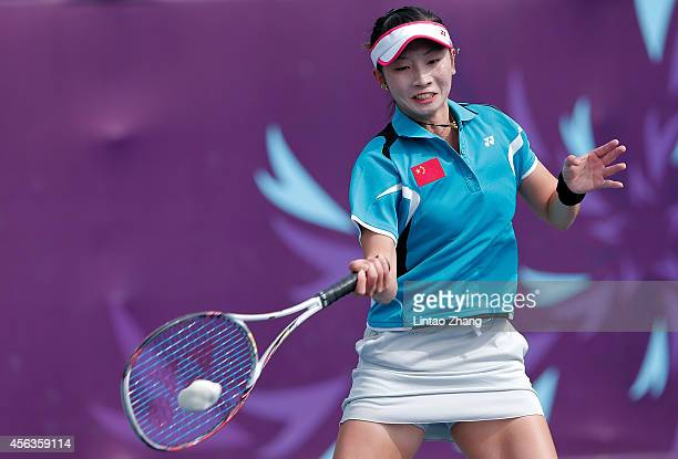 Zhong Yi of China returns a shot during the Soft Tennis Women's Singles Preliminary Group D against Stefanie Maya Rosa Ariana of Indonesia on day...