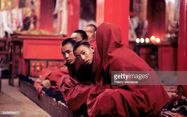 Zhongdian, Shangri-La, County, People's Republic of China, April 1997. -- Monks are praying in Songzanlin Temple