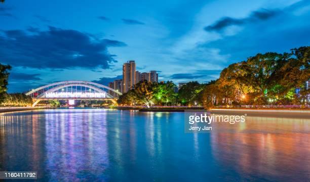 zhongshan city night view - zhongshan stock-fotos und bilder