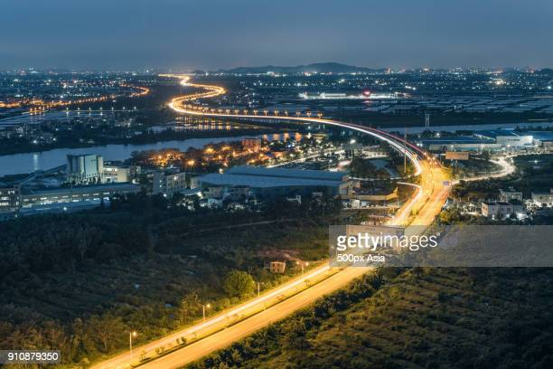 zhongshan city with highway at night, guangdong province, china - zhongshan stock-fotos und bilder