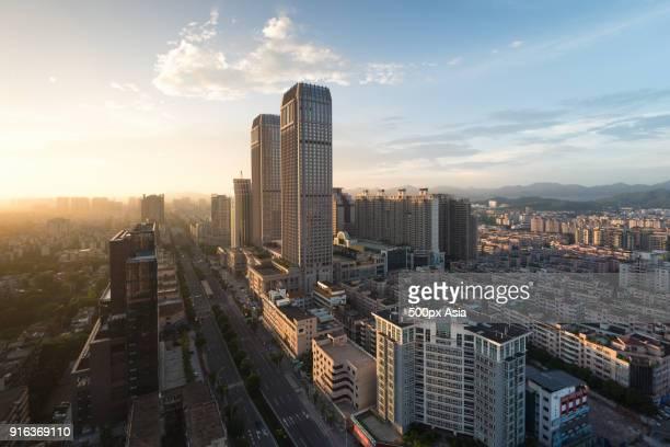 zhongshan city with skyscrapers at sunset, guangdong province, china - zhongshan stock-fotos und bilder