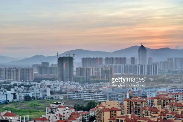 zhongshan tanzhou town skyline in sunset, gd, china - zhongshan stock-fotos und bilder