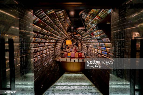 Zhongshuge bookstore located in Yangzhou city with mirrors and curves creating a mirage to symbolize the water significance to the historical Great...