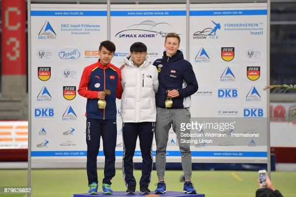 Zhongyan Ning of China Do Hyung Lee of South Korea and Gabriel Odor of Austria pose during the medal ceremony of the Men mass start the ISU Junior...