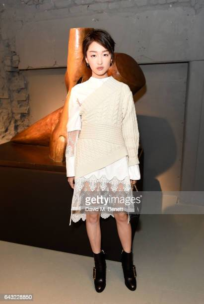Zhou Dong Yu wearing Burberry attends the Burberry February 2017 Show during London Fashion Week February 2017 at Makers House on February 20 2017 in...