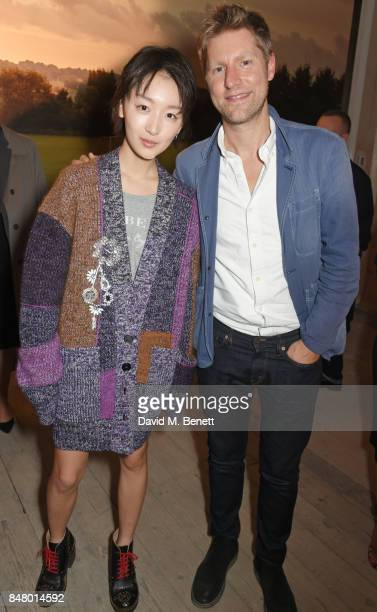 Zhou Dongyu and Christopher Bailey wearing Burberry at the Burberry September 2017 at London Fashion Week at The Old Sessions House on September 16...