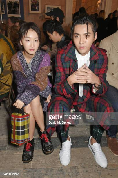 Zhou Dongyu and Kris Wu wearing Burberry at the Burberry September 2017 at London Fashion Week at The Old Sessions House on September 16 2017 in...