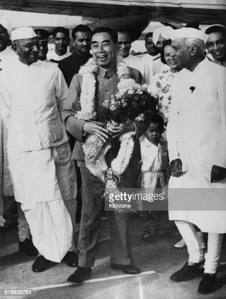 Zhou Enlai Premier of the People's Republic of China is greeted by Indian Prime Minister Jawaharlal Nehru on his arrival in New Delhi during a visit...